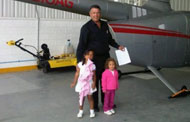 Jose Ricardo Cabrera with his granddaughters, in front of the Robinson R66 just before it crashed