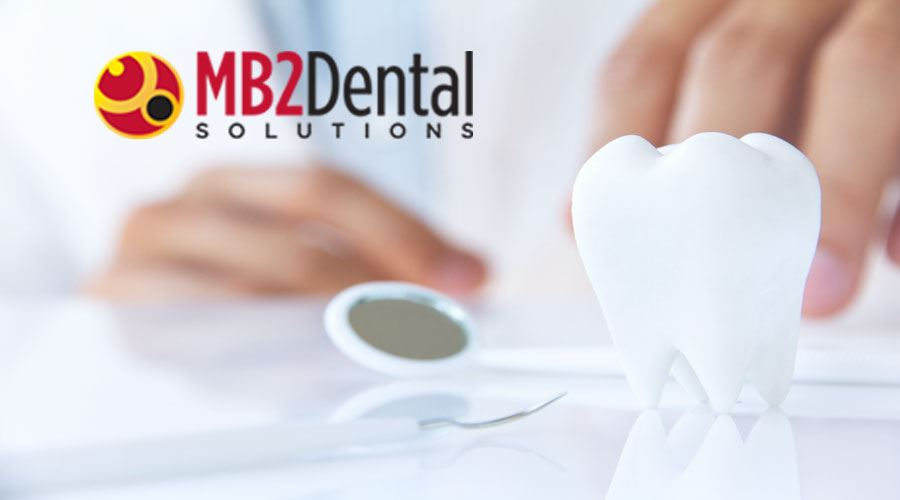 Dental tooth and equipment with MB2 Dental Solutions logo